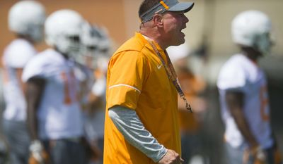 Head coach Butch Jones yells on the field during NCAA college football practice at Anderson Training Facility in Knoxville, Tenn., Saturday, July 29, 2017, in Knoxville, Tenn. (Catie McMekin/Knoxville News Sentinel via AP)
