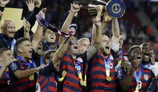 FILE - In this Wednesday, July 26, 2017, file photo, United States' Michael Bradley hoists the trophy as the team celebrates after beating Jamaica 2-1 in the Gold Cup final soccer match in Santa Clara, Calif.  U.S. coach Bruce Arena has used 47 players in 14 games since replacing Jurgen Klinsmann last November, including seven who made their national team debuts. He redefined roles of Clint Dempsey, Michael Bradley and Fabian Johnson, and boosted Jorge Villafana and Kellyn Acosta to the top tier of his depth chart.  (AP Photo/Marcio Jose Sanchez, File)