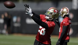 San Francisco 49ers running back Carlos Hyde makes a catch during the NFL team's football training camp Friday, July 28, 2017, in Santa Clara, Calif. (AP Photo/Marcio Jose Sanchez)