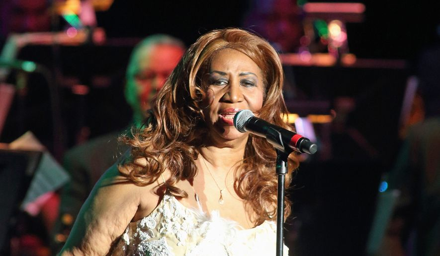 Aretha Franklin performs in concert at The Patricia and Arthur Model Performing Arts Center at The Lyric on Thursday, Nov. 13, 2014, in Baltimore. (Photo by Owen Sweeney/Invision/AP)