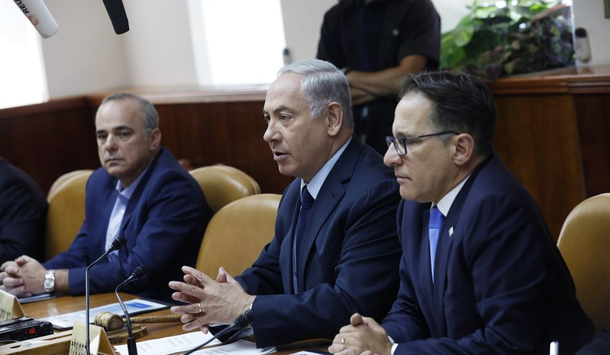 Israeli Prime Minister Benjamin Netanyahu, center, attends the weekly cabinet meeting in Jerusalem, Sunday,  July 30, 2017. (Amir Cohen, Pool via AP)