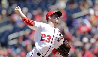 Washington Nationals starting pitcher Erick Fedde throws his first pitch in the Major League during the first inning of a baseball game between the Colorado Rockies and Washington Nationals, Sunday, July 30, 2017, in Washington. (AP Photo/Mark Tenally)