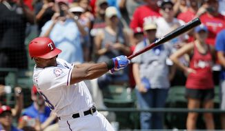 Texas Rangers' Adrian Beltre follows through on a double for his 3,000th career hit which came off a pitch from Baltimore Orioles' Wade Miley in the fourth inning of a baseball game, Sunday, July 30, 2017, in Arlington, Texas. (AP Photo/Tony Gutierrez)
