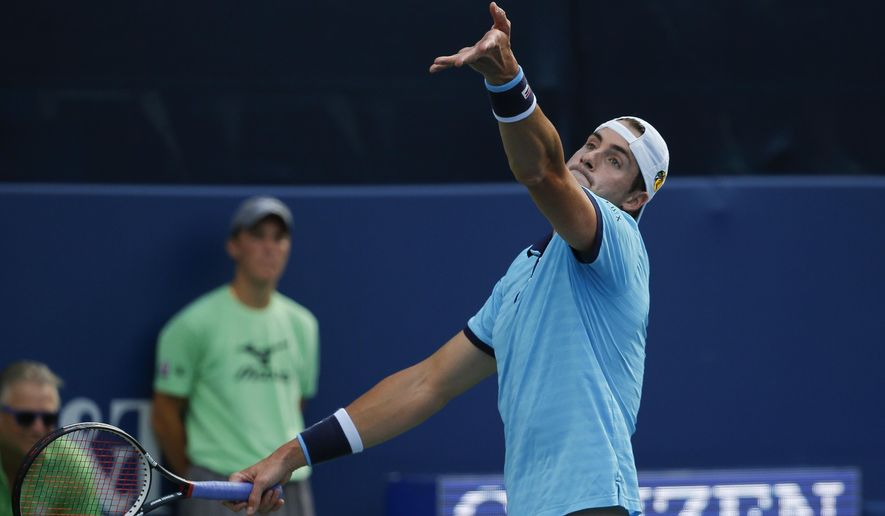 John Isner serves to Ryan Harrison during the finals of the Atlanta Open tennis tournament Sunday, July 30, 2017, in Atlanta. (AP Photo/John Bazemore)