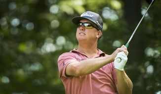 Charley Hoffman of the United States hits his tee shot on the 11th hole during the 2017 Canadian Open at the Glen Abbey Golf Club in Oakville, Ontario, Sunday, July 30, 2017. (Nathan Denette/The Canadian Press via AP)