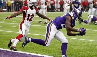 FILE- In this Nov. 20, 2016, file photo, Minnesota Vikings cornerback Xavier Rhodes, right, intercepts a pass in the end zone in front of Arizona Cardinals wide receiver John Brown (12) during the first half of an NFL football game in Minneapolis. The Vikings announced Sunday, July 30, 2017, that they signed Rhodes to a five-year contract extension. (AP Photo/Andy Clayton-King, File)