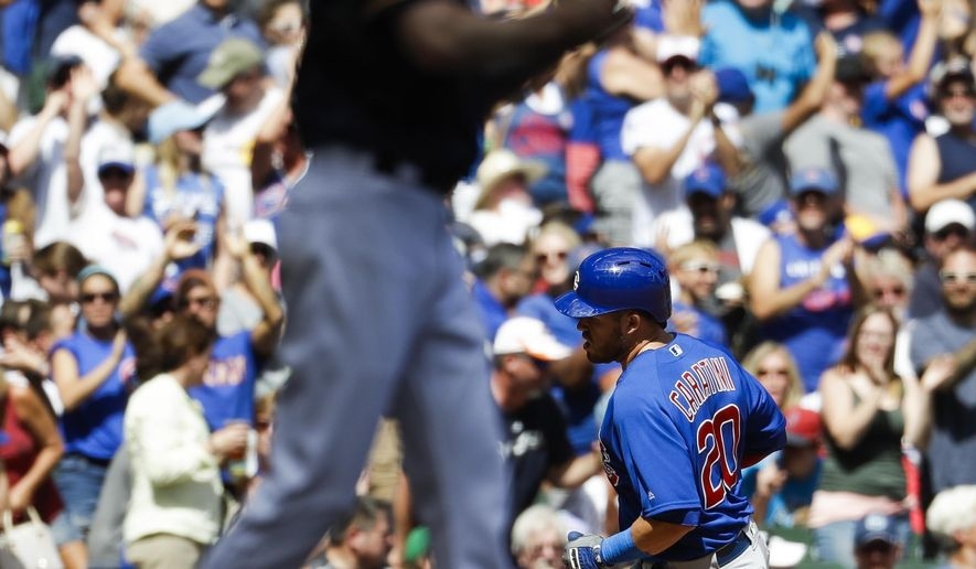Chicago Cubs' Victor Caratini rounds the bases after hitting a home run during the seventh inning of a baseball game against the Milwaukee Brewers Sunday, July 30, 2017, in Milwaukee. (AP Photo/Morry Gash)