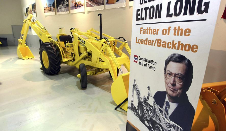 FOR RELEASE SUNDAY, JULY 30, 2017, AT 12:01 A.M. CDT.-In this Nov. 8, 2011, photo a backhoe is seen at an event honoring Elton Long, the father of the backhoe-loader, for his induction into the Construction Equipment Hall of Fame at the visitors center of Case Construction Equipment's Burlington, Iowa, plant. (John Lovretta/The Hawk Eye via AP)