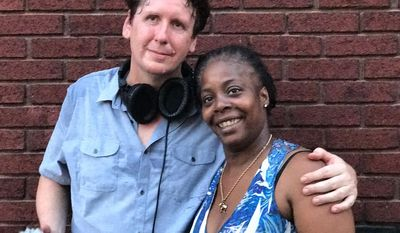 "ADVANCE FOR WEEKEND EDITIONS - In this July 20, 2017, photo, Trey Kay, left, and Deanna McKinney, who is featured in the first podcast of a four-part series on Charleston's West Side that Kay is producing for his ""Us & Them"" podcast, in Charleston, W.Va. (Douglas Imbrogno/Charleston Gazette-Mail via AP)"