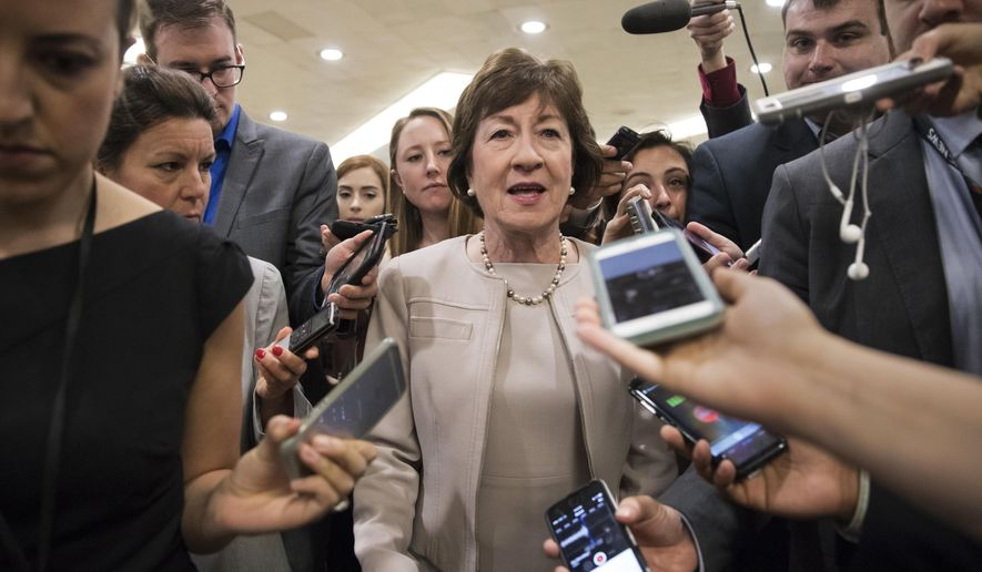 "In this Tuesday, July 25, 2017, photo, Sen. Susan Collins, R-Maine, is surrounded by reporters as she arrives on Capitol Hill in Washington, before a test vote on the Republican health care bill. Collins, who was one of three Republican senators voting against the GOP health bill on Friday, July 28, said she's troubled by Trump's suggestions that the insurance payments are a ""bailout."" (AP Photo/J. Scott Applewhite, File)"