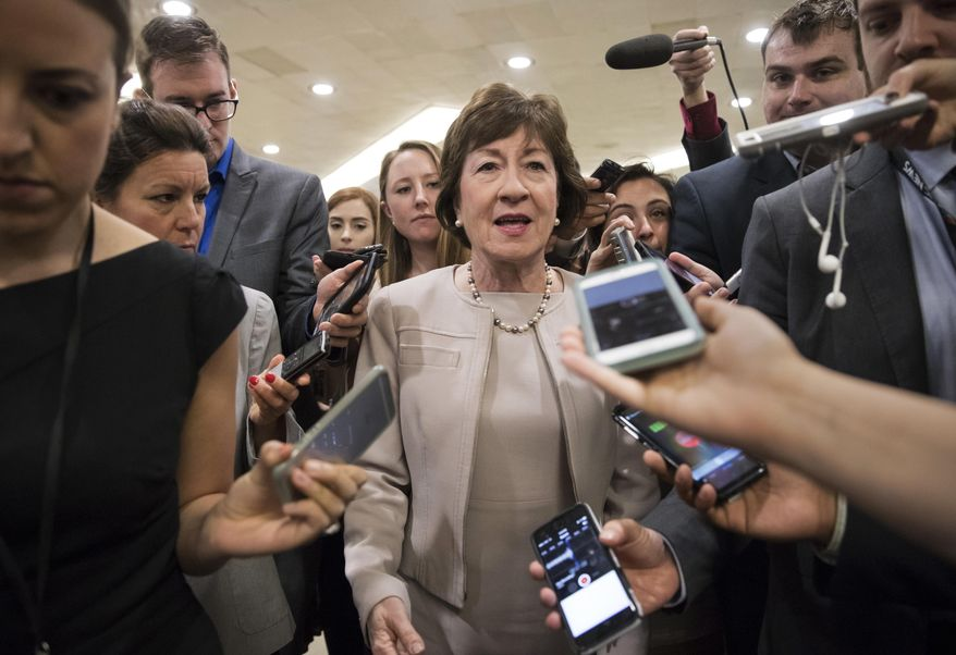 """In this Tuesday, July 25, 2017, photo, Sen. Susan Collins, R-Maine, is surrounded by reporters as she arrives on Capitol Hill in Washington, before a test vote on the Republican health care bill. Collins, who was one of three Republican senators voting against the GOP health bill on Friday, July 28, said she's troubled by Trump's suggestions that the insurance payments are a """"bailout."""" (AP Photo/J. Scott Applewhite, File)"""