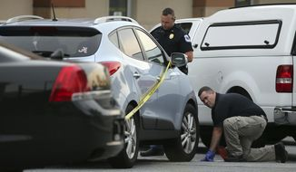 In this June 18, 2014, file photo Cobb County police investigate an SUV where a toddler died near Marietta, Ga., when the father forgot to drop his child off at day care and went to work. A proposed new law that would require carmakers to build alarms for backseats is being pushed by child advocates who say it will prevent kids from dying in hot cars and also streamline the criminal process against caregivers who cause the deaths, cases that can be inconsistent but often heavier-handed against mothers. The latest deaths came in Arizona on triple-digit degree days over the last weekend of July 2017. (Ben Gray/Atlanta Journal Constitution via AP, File) **FILE**