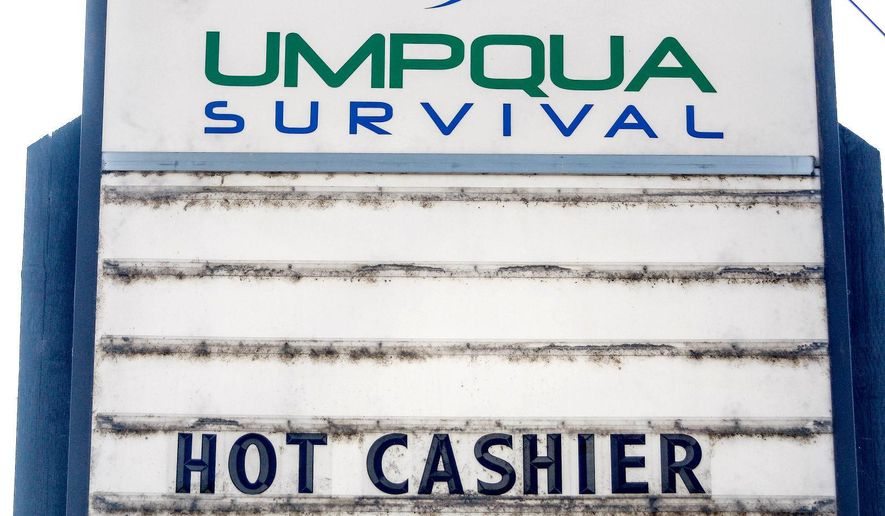 This Monday, July 17, 2017, photo shows a sign outside the Umpqua Survival Store in Roseburg, Ore. (Mike Henneke/The News-Review via AP)