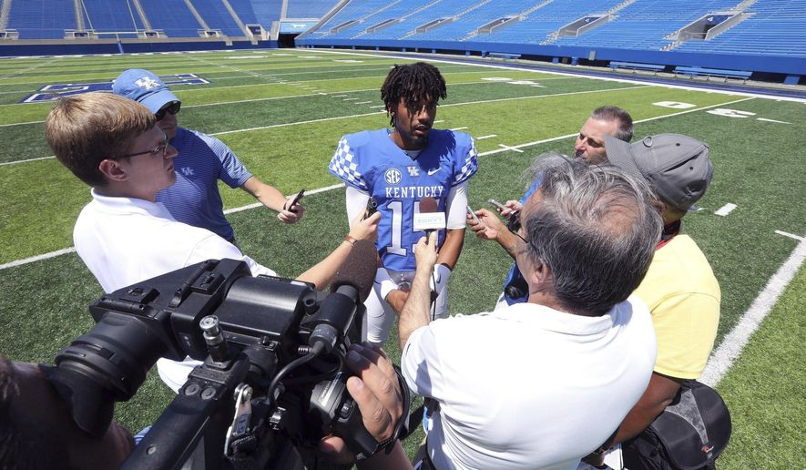 Stephen Johnson chats with media members during an NCAA college football media day in Lexington, Ky., Sunday, July 30, 2017. (Alex Slitz/Lexington Herald-Leader via AP)