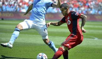 Toronto FC's Sebastian Giovinco, right, works the ball around New York City FC's Frederic Brillant during the first half of their MLS soccer game, Sunday July 30, 2017 in Toronto. (Jon Blacker/The Canadian Press via AP)