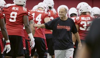 Nebraska head coach Mike Riley greets players on the first day of preseason practice, in Lincoln, Neb., Sunday, July 30, 2017. (AP Photo/Nati Harnik)