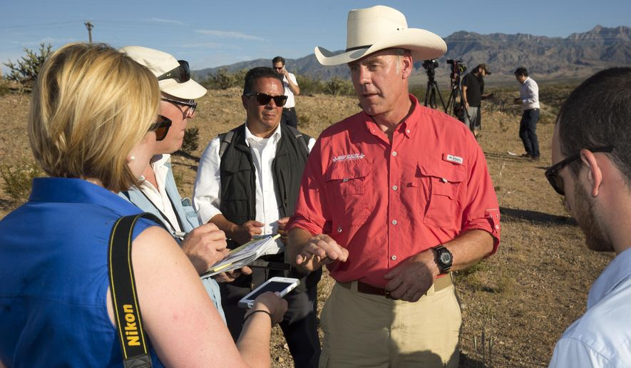 U.S. Interior Secretary Ryan Zinke speaks with members of the media during a news conference near Gold Butte National Monument in Bunkerville, Nev., Saturday, July 30, 2017. Zinke is touring several national monuments as part of an ongoing review. (Steve Marcus/Las Vegas Sun via AP)