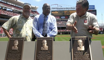 FILE- In this July 16, 2006, file photo, former Cincinnati Reds players Tom Browning, Lee May and Tom Seaver, from left, stand next to their plaques during a ceremony inducting them into the Reds Hall of Fame before the baseball game against the Colorado Rockies in Cincinnati. May, an All-Star slugger who put up 100-RBI seasons for three different teams, has died. He was 74. The Reds said Sunday, July 30, 2017, that May died over the weekend. (AP Photo/Tom Uhlman, File)