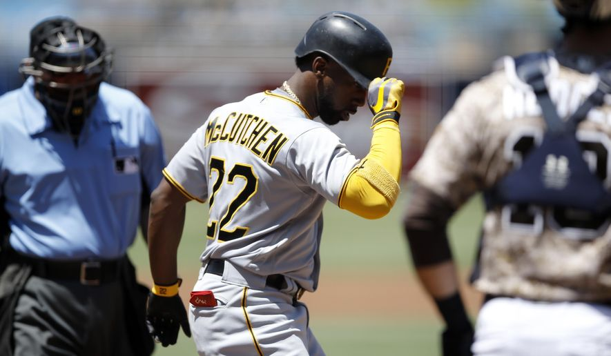 Pittsburgh Pirates center fielder Andrew McCutchen, center, gestures at the plate with umpire Dana DeMuth, left, and San Diego Padres catcher Austin Hedges watching after returning from a solo home run  during the first inning of a baseball game in San Diego, Sunday, July 30, 2017. (AP Photo/Alex Gallardo)