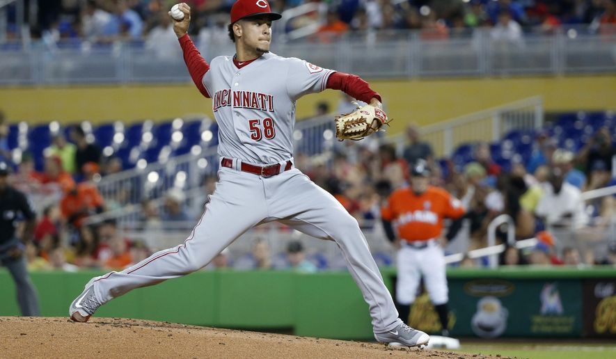 Cincinnati Reds' Luis Castillo delivers a pitch during the first inning of a baseball game against the Miami Marlins, Sunday, July 30, 2017, in Miami. (AP Photo/Wilfredo Lee)