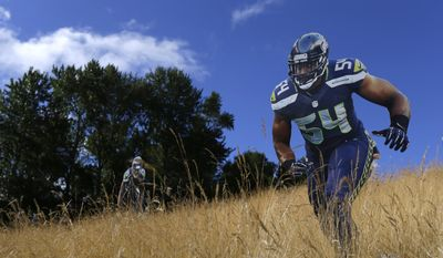 A life-size figure of Seattle Seahawks middle linebacker Bobby Wagner is displayed at NFL football training camp, Sunday, July 30, 2017, in Renton, Wash. (AP Photo/Ted S. Warren)