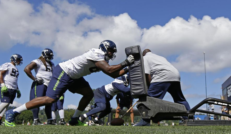 Seattle Seahawks defensive end Shaneil Jenkins hits a blocking sled during an NFL football training camp, Sunday, July 30, 2017, in Renton, Wash. (AP Photo/Ted S. Warren)