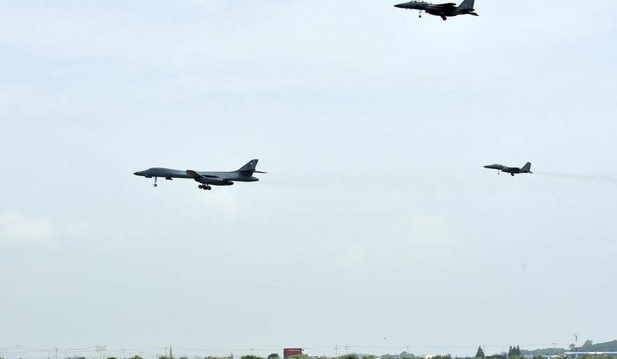 In this photo provided by South Korea Defense Ministry, a U.S. Air Force B-1B bomber, left, flies with South Korean F-15K fighter jets over Osan Air Base in Pyeongtaek, South Korea, Sunday, July 30, 2017. The United States flew two supersonic bombers over the Korean Peninsula on Sunday in a show of force against North Korea following the country's latest intercontinental ballistic missile test. (South Korea Defense Ministry via AP)