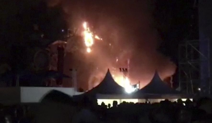 """In this image made from video provided by David Belmonte, flames engulf the outdoor stage during the """"Tomorrowland"""" electronic music festival in Barcelona, Spain, Saturday night, July 29, 2017. A spectacular fire at the music festival forced the evacuation of over 20,000 concertgoers, the regional government says. (David Belmonte via AP)"""