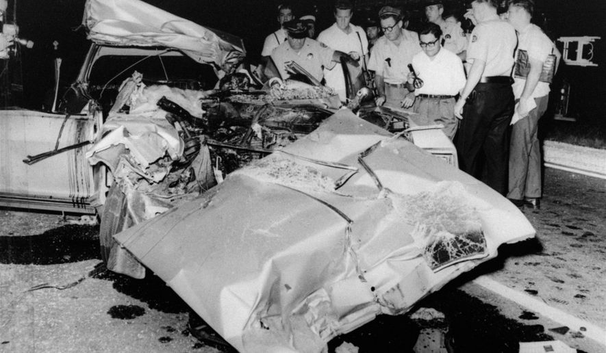 FILE - This June 29, 1967, file photo shows the mangled car that actress Jayne Mansfield died in after colliding with a truck, on Route 90 outside of New Orleans. Fifty years after Mansfield car slammed underneath a tractor-trailer, auto safety advocates say hundreds of similar deaths annually could be prevented by guard rails mounted beneath trucks. New York Sen. Charles Schumer has called on federal regulators to require truck underride guards after two cars skidded under a jackknifed milk tanker in northern New York earlier this month. (AP Photo/File)