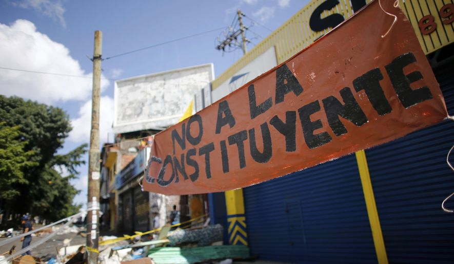"A banner that reads in Spanish ""No to the Constituent Assembly"" seen at Petare neighborhood in Caracas, Venezuela, Saturday, July 29, 2017. Despite four months of deadly protests and the threat of U.S. sanctions, Venezuela on Saturday found itself 24 hours away from a consolidation of government power that appeared certain to drag the OPEC nation deeper into a crisis that has entire neighborhoods battling police and paramilitaries while the poor root for scraps in piles of trash. (AP Photo/Ariana Cubillos)"