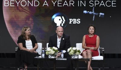 "Beth Hoppe, chief programming executive, PBS, from left, and astronauts Scott Kelly and Jessica Meir participate in the ""Beyond a Year in Space"" panel during the PBS Television Critics Association Summer Press Tour at the Beverly Hilton on Monday, July 31, 2017, in Beverly Hills, Calif. (Photo by Richard Shotwell/Invision/AP)"