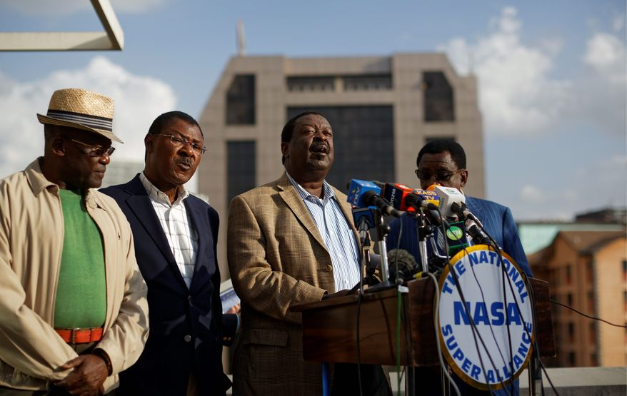Officials from the opposition National Super Alliance, from left to right, Johnson Muthama, Moses Wetangula, Musalia Mudavadi, and James Orengo, give their reaction to the media regarding the torture and death of an electoral commission official, in Nairobi, Kenya Monday, July 31, 2017. Christopher Msando, an information technology official crucial to running Kenya's presidential election next week, has been found tortured and killed, the electoral commission chairman said Monday, as concerns grew that the East African nation's vote again would face dangerous unrest. (AP Photo/Ben Curtis)