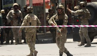 Security forces respond at the site of a suicide attack followed by a clash between Afghanistan's forces and IS fighters during an attack on Iraq embassy in Kabul, Afghanistan, Monday, July 31, 2017. A media outlet linked to the Islamic State group says two IS militants were behind the attack on the Iraqi Embassy in the Afghan capital. (AP Photos/Massoud Hossaini)