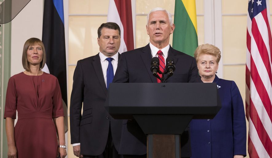 U.S. Vice President Mike Pence, second from right, accompanied by the leaders of Baltic states, from left, Estonian President Kersti Kaljulaid, Latvian President Raimonds Vejonis and Lithuanian President Dalia Grybauskaite, speaks during a news conference following their meeting in the Kadriorg Palace in Tallinn, Estonia, Monday, July 31, 2017. Pence is visiting Estonia to meet the leaders to underscore America's commitment to NATO and convey Washington's support to the Baltic nations. (AP Photo/Mindaugas Kulbis)