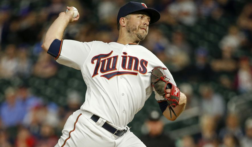 FILE - In this June 20, 2017, file photo, Minnesota Twins relief pitcher Brandon Kintzler throws to the Chicago White Sox during the ninth inning of a baseball game in Minneapolis. The first-place Washington Nationals have added another late-inning reliever by acquiring right-hander Kintzler from the Twins. (AP Photo/Bruce Kluckhohn, File)