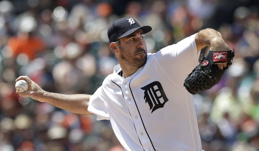 FILE - In this July 30, 2017, file photo, Detroit Tigers starting pitcher Justin Verlander throws during the first inning of a baseball game against the Houston Astros, in Detroit. (AP Photo/Carlos Osorio, File)