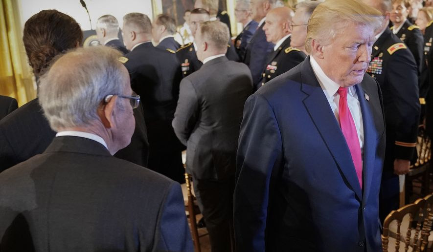 President Donald Trump leaves the room after bestowing the nation's highest military honor, the Medal of Honor to retired Army medic James McCloughan during a ceremony in the East Room of the White House in Washington, Monday, July 31, 2017. (AP Photo/Pablo Martinez Monsivais)