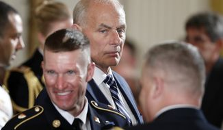 White House Chief of Staff John Kelly, center, stands before a ceremony where President Donald Trump bestows the nation's highest military honor, the Medal of Honor, to retired Army medic James McCloughan during a ceremony in the East Room of the White House, Monday, July 31, 2017, at Washington. McCloughan is credited with saving the lives of members of his platoon nearly 50 years ago in the Battle of Nui Yon Hill in Vietnam. (AP Photo/Alex Brandon)