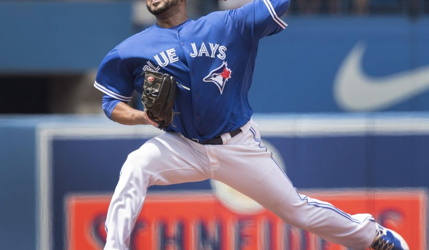 Toronto Blue Jays starting pitcher Francisco Liriano throws against the Los Angeles Angels during the first inning of their AL baseball game in Toronto on Saturday, July 29, 2017. (Fred Thornhill/The Canadian Press via AP)