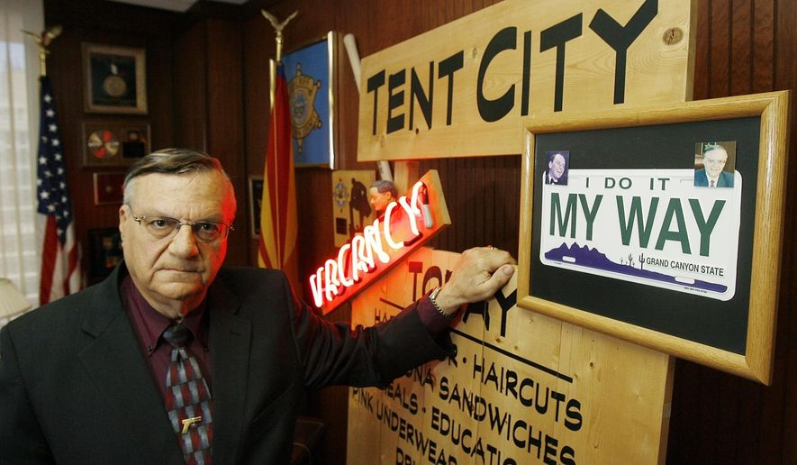 FILE--In this April 17, 2008, file photo, Maricopa County Sheriff Joe Arpaio next to some of his memorabilia in his office in Phoenix. Arpaio has been convicted of a criminal charge Monday, July 31, 2017, for disobeying a court order to stop traffic patrols that targeted immigrants in a conviction that marks a final rebuke for the former sheriff and politician who once drew strong popularity from such crackdowns but was booted from office amid voter frustrations over his deepening legal troubles. (AP Photo/Ross D. Franklin, file)