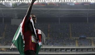FILE - In this Monday, Aug. 15, 2016 file photo, Kenya's David Lekuta Rudisha celebrates winning the men's 800-meter final during the athletics competitions of the 2016 Summer Olympics at the Olympic stadium in Rio de Janeiro, Brazil. David Rudisha has withdrawn from the world athletics championships. The two-time Olympic champion confirmed his withdrawal on Monday, July 31, 2017 via Twitter and will not defend his 800-meter title due to injury. (AP Photo/Natacha Pisarenko, file)