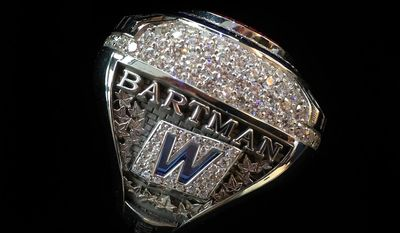 This photo provided by the Chicago Cubs baseball team shows a 2016 World Series championship ring the team announced Monday, July 31, 2017, they were giving to Steve Bartman, the fan remembered for deflecting a foul ball that appeared destined to land in left fielder Moises Alou's glove with Chicago five outs from the World Series in 2003. (Chicago Cubs via AP)