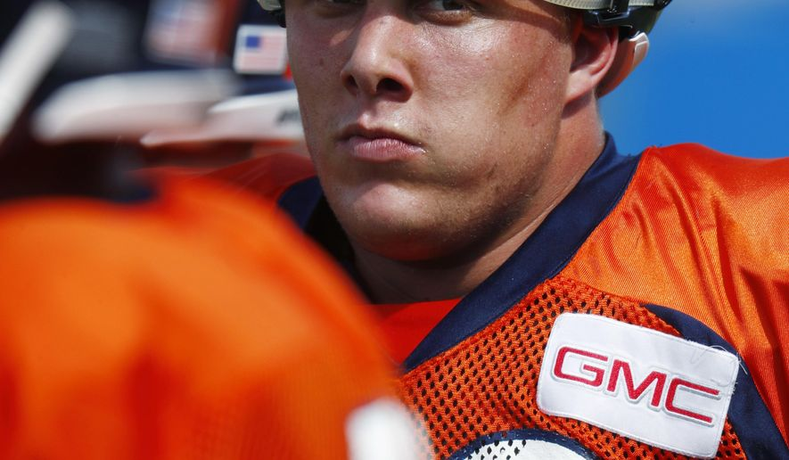 Denver Broncos offensive tackle Garett Bolles takes a break during drills at an NFL football training camp Monday, July 31, 2017, in Englewood, Colo. (AP Photo/David Zalubowski)