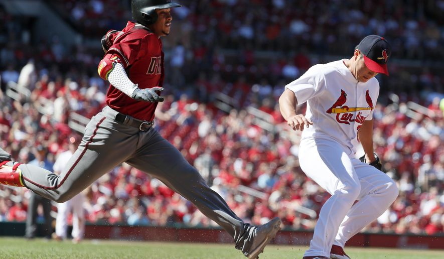 Arizona Diamondbacks' Ketel Marte, left, is out as St. Louis Cardinals relief pitcher Seung-Hwan Oh beats Marte to first during the eighth inning of a baseball game, Sunday, July 30, 2017, in St. Louis. The Cardinals won 3-2. (AP Photo/Jeff Roberson)