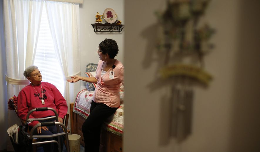 In this July 19, 2017, photo, nurse Sandy Miller, right, chats with patient Martha Hays, left, at the Hays home in Columbus, Ohio. U.S. Census estimates show the number of elderly people in the country is expected to more than double by 2050 to nearly 89 million, creating a growing need for more care workers. Geriatric care management has become a growing field. (Joshua A. Bickel/The Columbus Dispatch via AP)