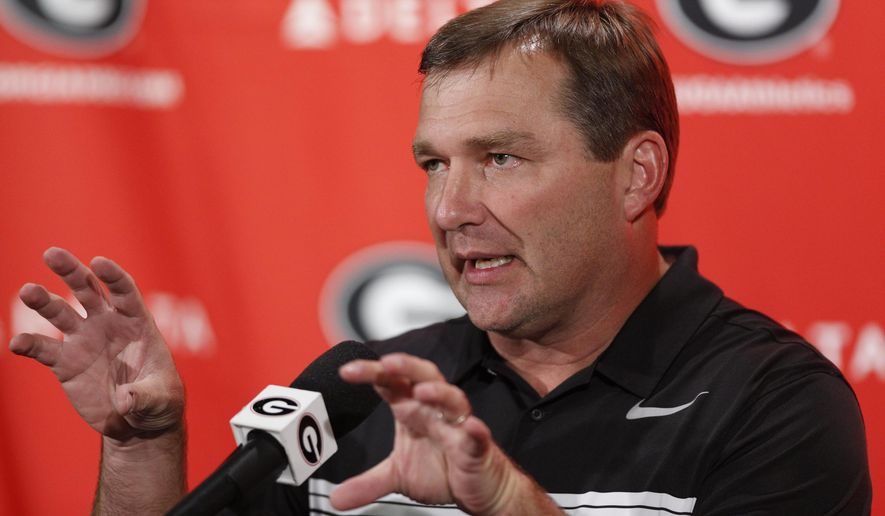 Georgia NCAA college football coach Kirby Smart gestures while speaking to the media on the first day of training camp in Athens, Ga., Monday, July 31, 2017. (Joshua L. Jones/Athens Banner-Herald via AP)