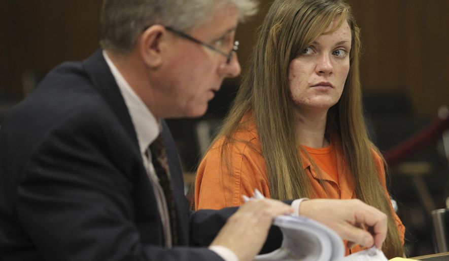 FILE - In this Tuesday Dec. 7, 2010 file photo, convicted murderer Sarah Johnson listens to her attorney, Christopher Simms, during her court hearing in Twin Falls, Idaho, to have her 2005 conviction for murdering her parents overturned. Simms says Johnson was unfairly convicted of killing her parents in 2003, at the age of 16, because police investigators failed to consider other suspects and a previous defense attorney who was unprepared. (Ashley Smith/The Times-News via AP)
