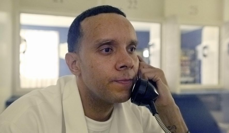 In this Wednesday, June 21, 2017 photo, inmate Jason Robinson, 39, listens to a question during an interview in the Texas state prison in Gatesville, Texas. Robinson was convicted of murder at 16 and sentenced to automatic life with the possibility of parole. (AP Photo/Jaime Dunaway)