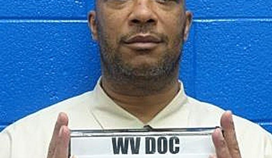 This undated photo released by the West Virginia Department of Corrections in 2017 shows convicted murderer John Moss Jr. A handful of West Virginia inmates sentenced to life in prison without parole for murders committed as juveniles, including Moss, will have their cases reviewed in 2017. (West Virginia Department of Corrections via AP)