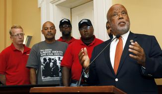 U.S. Rep. Bennie Thompson, D-Miss., right, expresses his desire for a company intimidation free union vote at the Nissan vehicle assembly plant in Canton, Miss., during a Jackson, Miss., news conference, Monday, July 31, 2017, where he was joined by local the mayors of Canton and Jackson. Joining Thompson were Nissan employees Travis Parks, left, Lee Ruffin, second from left, Eric Hearn, center and Ernest Whitfield, second from right. The UAW has a vote scheduled Aug. 3-4, on whether it should represent some 3,700 workers. (AP Photo/Rogelio V. Solis)